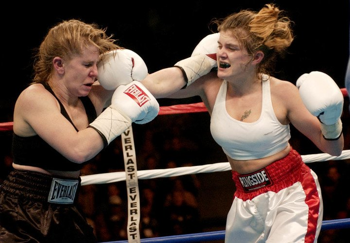 Tonya Harding gets the punishment in her professional debut.  He fell for points.  AP Pictures