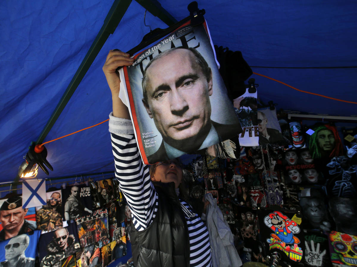 Photo: A Putin-faced shirt seller in St. Petersburg on August 31, 2014, after the outbreak of war in eastern Ukraine.  (Reuters)