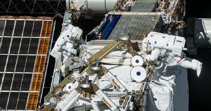 Container.  Astronauts prepare the International Space Station to install new solar panels