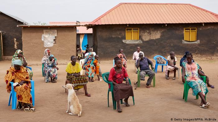 A rural community in Africa that sits outdoors and walks apart