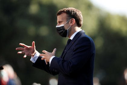 French President Emmanuel Macron speaks to the media upon his arrival at the European Union summit at Crystal Palace in Porto, Portugal, on May 8, 2021. Francisco Seco / Pool via Reuters