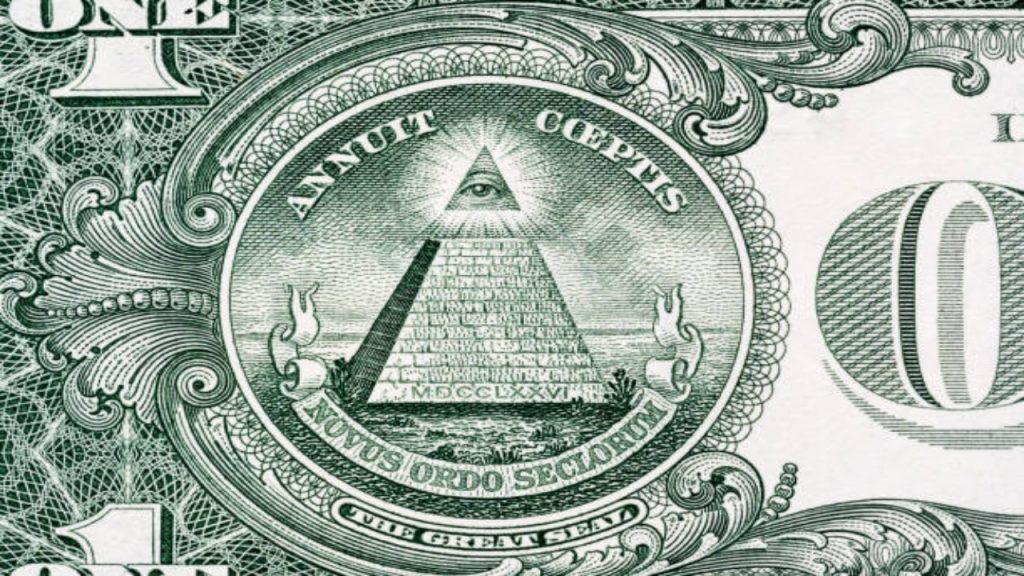 What do the symbols on the dollar bill mean?
