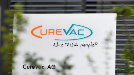 (Files) In this file photo taken on June 23, 2020, the logo of the biopharmaceutical company CureVac appears in front of the company's headquarters in Tübingen, southern Germany on June 23, 2020. -- German biotech company CureVac, developed by the coronavirus vaccine, reportedly attracted interest US President Donald Trump, and is set to make his Nasdaq debut on August 14, 2020 after raising more than $200 million in his New York initial public offering.  (Photo by Thomas Kinzel/AFP)