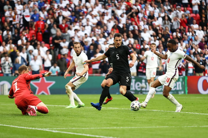 Raheem Sterling scores England's first goal against Germany.