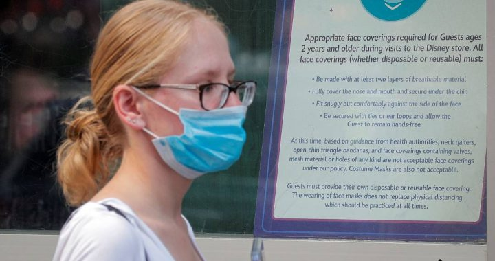US asks COVID-19 vaccinators to continue wearing face masks