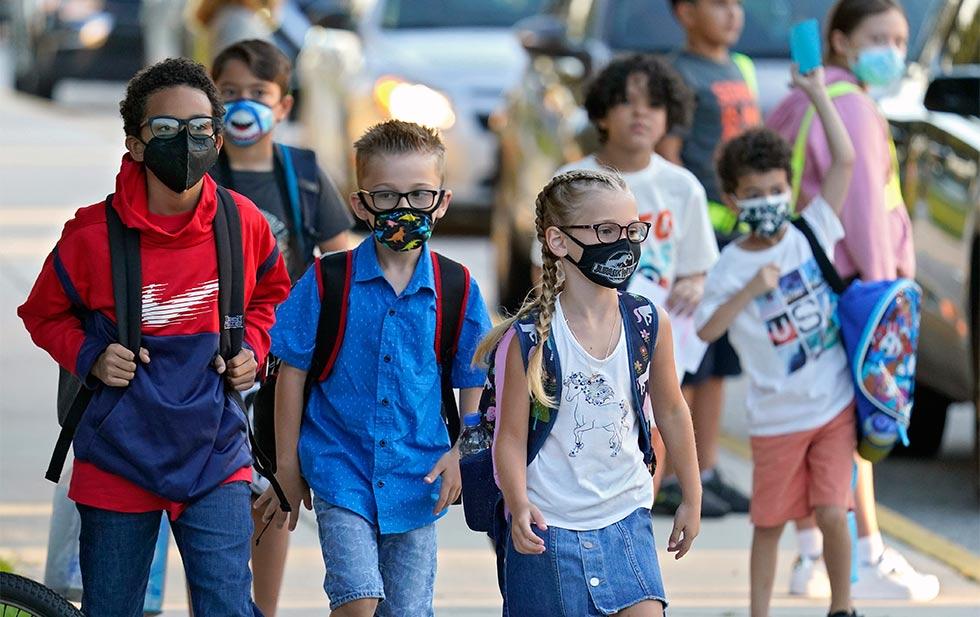 Biden calls on school administrators to defy anti-mask rules