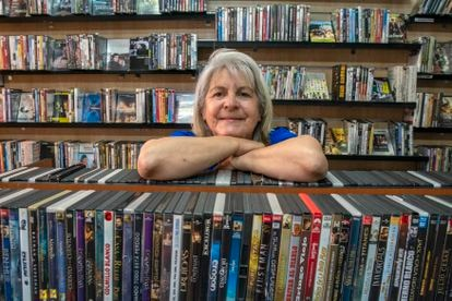 Marcia Ciboro standing inside her Blue Ray DVD and rental store
