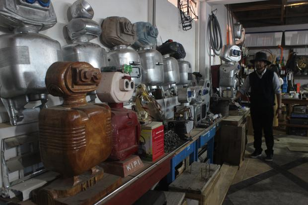 Professor Walter Velasquez displays some of the prototypes found in his lab.  (Photo: Yerson Kolav)