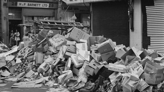 Piles of trash on the streets of London in 1970.