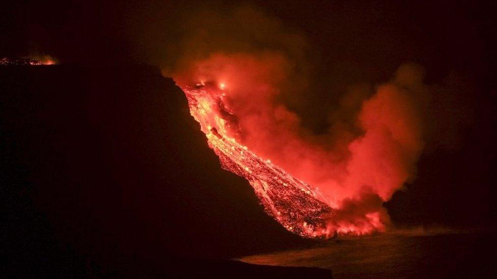 Lava from La Palma volcano reaches the sea